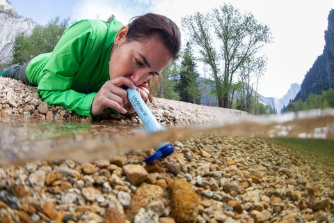 Person drinking with LifeStraw filter